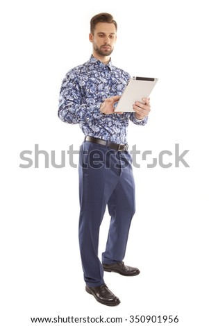 The man uses the tablet