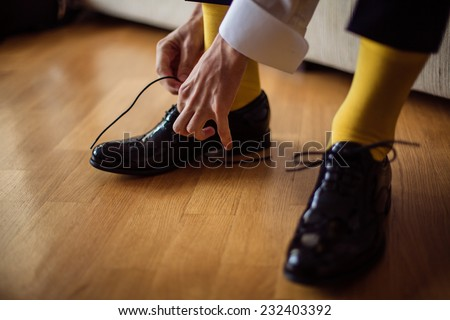 The man wears shoes. Yellow socks. - stock photo