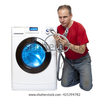 The man who has thought of repair or connection of the washing machine near the new washing machine - stock photo