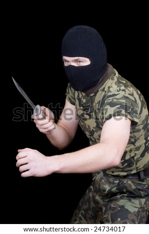 The man with a knife in a black mask - stock photo