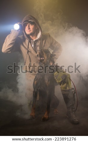 The man with a lantern and a dog - stock photo