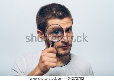 The man with a magnifier - stock photo