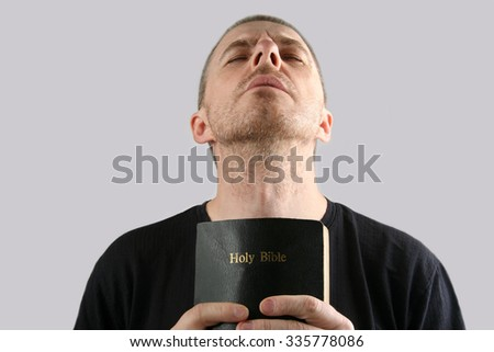 the man with the Bible in their hands makes prayer