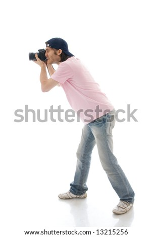 The man with the camera isolated on a white background - stock photo