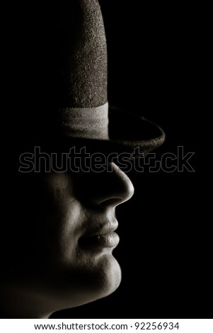 The man with the hat. On a black background - stock photo