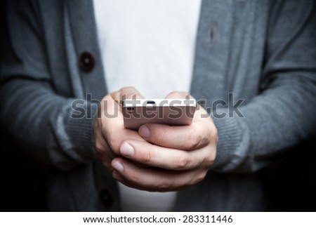The man with the phone in his hand. Photography in low key - stock photo