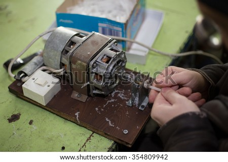 The man works at the old manual equipment - stock photo