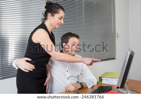 The manager flirting with his attractive secretary - stock photo