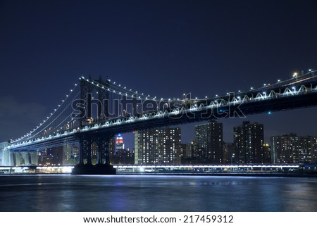 The Manhattan Bridge is a suspension bridge that crosses the East River in New York City, connecting Lower Manhattan with Brooklyn.