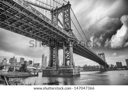 The Manhattan Bridge, New York City. Awesome wideangle upward view. - stock photo