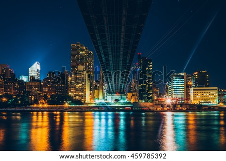 The Manhattan Skyline seen from under the Queensboro Bridge on Roosevelt Island, New York. - stock photo
