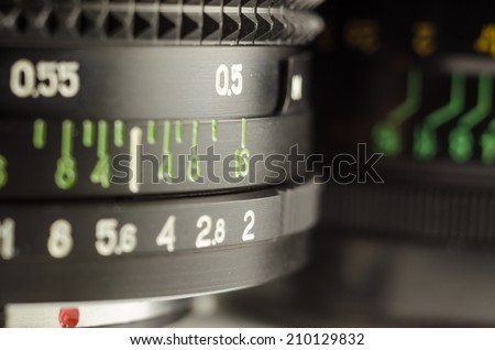 The manual camera lens, focus and exposure controls - stock photo