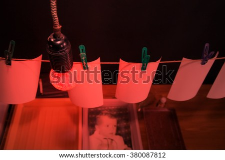 The manual process printingof old photos. Drying photos on rope - stock photo
