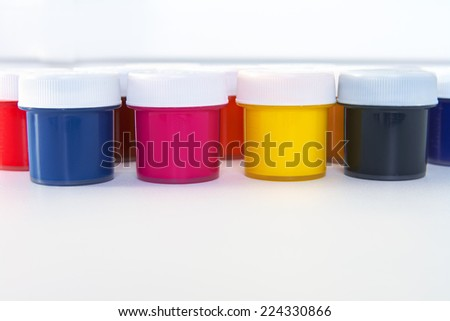 The many colored paint bucket CMYK - stock photo