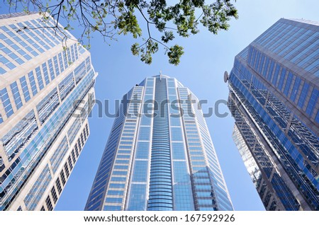 the many Glass windows on building centre business - stock photo