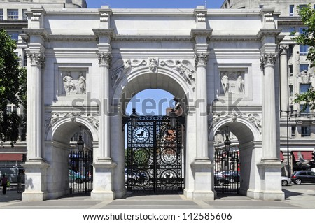 The Marble Arch monument and gates with Oxford Street beyond West End London England UK - stock photo