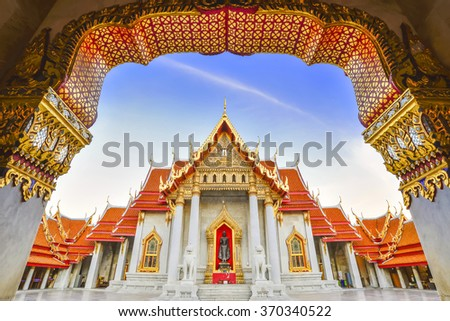 the marble temple in Bangkok city  from the entrance view with the twilight scene before the sunset.Beautiful temple at Bangkok city with the twilight scene.Buddha  temple at Bangkok city in Thailand. - stock photo