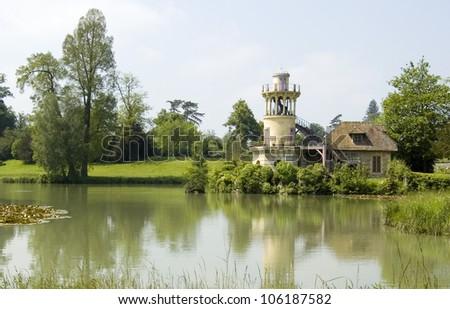 The Marlborough Tower in the Queen's Hamlet (Hameau de la Reine) in Versailles. - stock photo