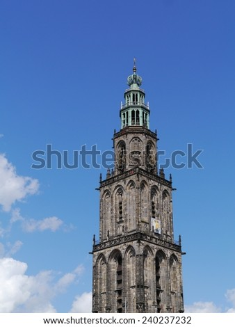 The Martini tower or Martinitoren is the highest church steeple in the city Groningen in the Netherlands and is the bell tower of the Martinikerk or Martini church - stock photo