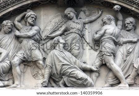 The Martyrdom of St. Stephen pediment of the front door of the Saint Etienne du Mont Church, Paris. - stock photo
