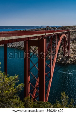 The Maslenica Bridge is a deck arch bridge carrying the D8 state road approximately 1 km to the west of the settlement of Maslenica, Croatia - stock photo