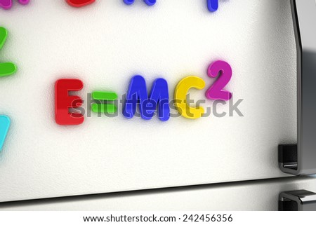The mass - energy equivalence written on a refrigerator door with magnet letters - stock photo