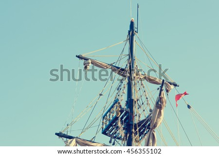 The mast of a pirate ship against the sky - stock photo