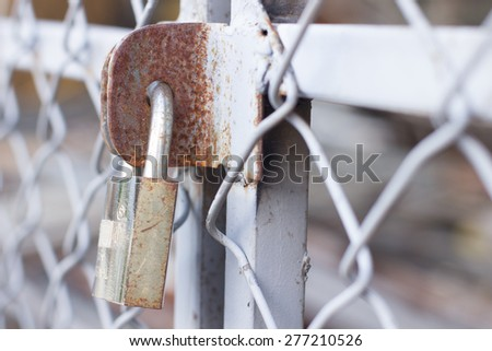 The master key is locking the iron bar,padlock,the hinged lock