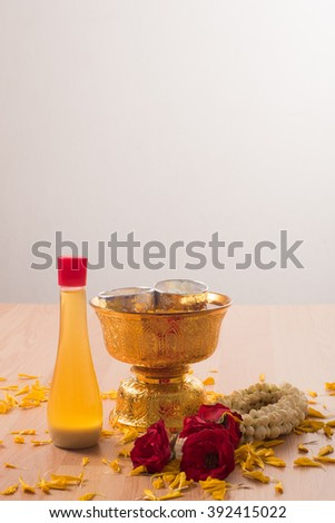 The materials for pouring water on black adults.In clued Garland of fresh flowers,thai perfume,tray with pedestal for songkran festival, Thailand - stock photo