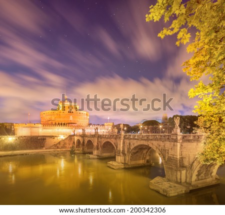 The Mausoleum of Hadrian, Castel Sant'Angelo Castle of Holy Angel and the Sant'Angelo bridge, Ponte Sant'Angelo illuminated by night. Rome, Italy - stock photo