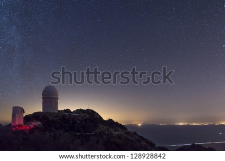 The Mayall observatory at Kitt Peak overlooks Tucson, Arizona on a clear starry night