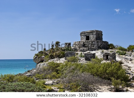 The Mayan ruins of the Temple of the Wind in Tulum Mexico.  Tulum is located in the Yucatan Peninsula.  - stock photo