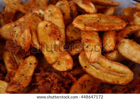 The meal of banana fried. Delicious snacks bananas fried in hot oil.  - stock photo