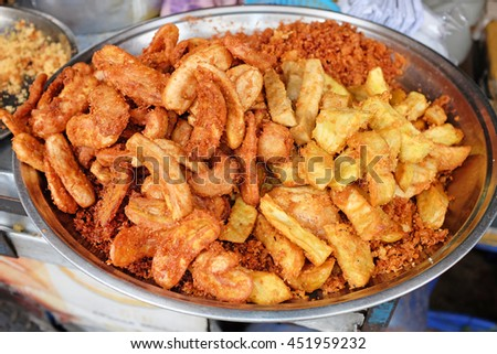 The meal of potato and banana fried. Delicious snacks fried in hot oil. - stock photo