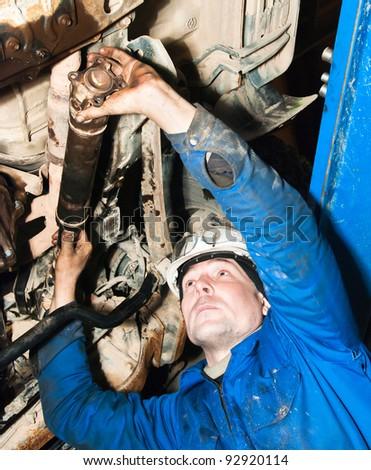 The mechanic repairs the car - stock photo