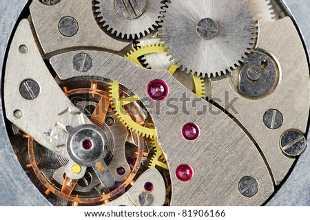 The mechanism of old hours. A photo close up. - stock photo