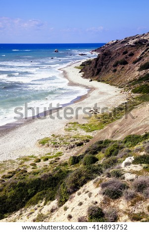 The Mediterranean island country of Cyprus coastline, shoreline, beach with the Mediterranean sea and a blue sky and sea with some copy space - stock photo