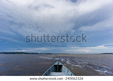 The Meeting of Waters in Manaus on boat, the confluence between the Rio Negro and Rio Solim�µes - stock photo