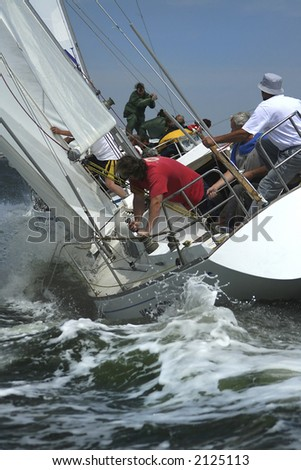 The men work with navigation of a yacht in the difficult storm sea. The present man's sports it yachting! - stock photo
