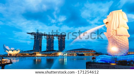 The Merlion fountain lit up at night in Singapore. - stock photo
