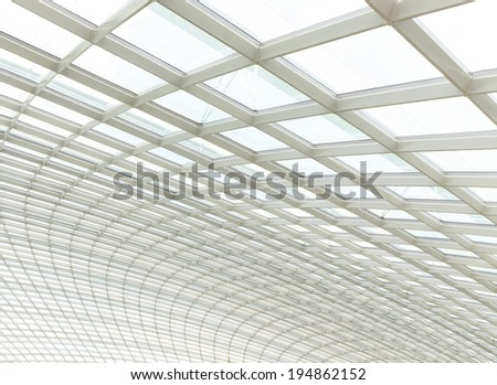 the metal and glass roof inside of office center - stock photo