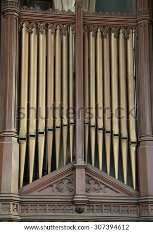 The Metal Pipes of a Church Music Organ. - stock photo