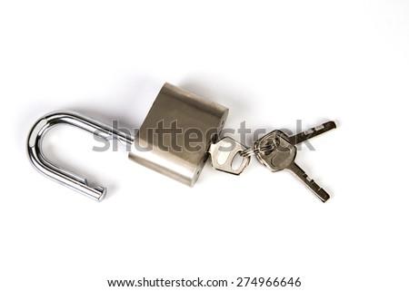 the Metallic padlock with the key on white background - stock photo