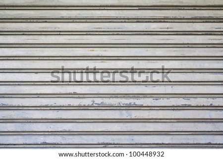 The metallic pattern of industrial gate - stock photo