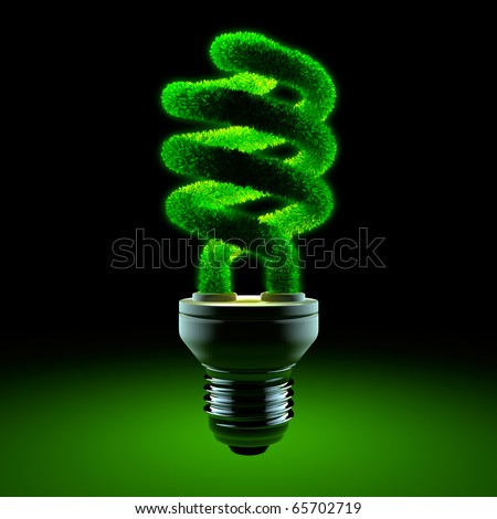 The metaphor of energy saving lamps - glass twisted tube is covered with grass, and shining in the darkness - stock photo