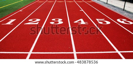 The 100 meter start looking down a red track with white lines