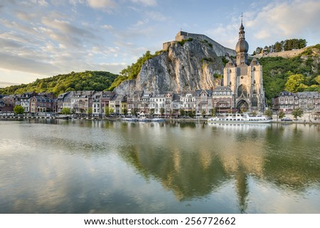 The Meuse River passing through the town of Dinant, located in the Walloon, Belgium. - stock photo