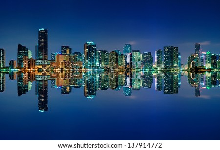 The Miami skyline at night with almost no clouds and nearly perfect reflections - stock photo