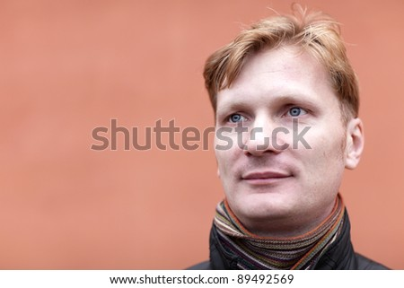 The mid adult man posing on the red background - stock photo