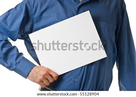 The mid section of a man in a blue dress shirt, holding a blank white sign, isolated on white.
